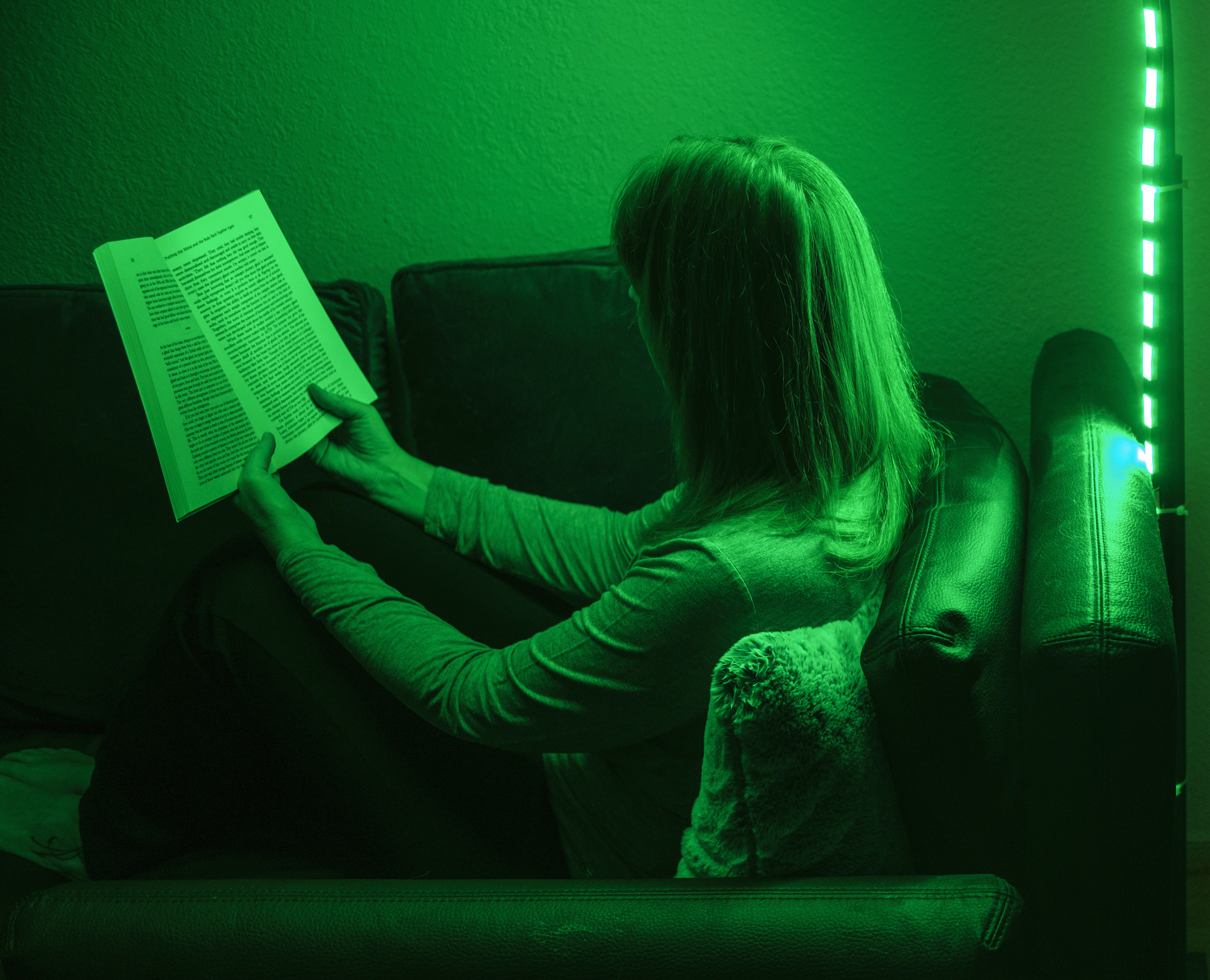 a person reading by a green light