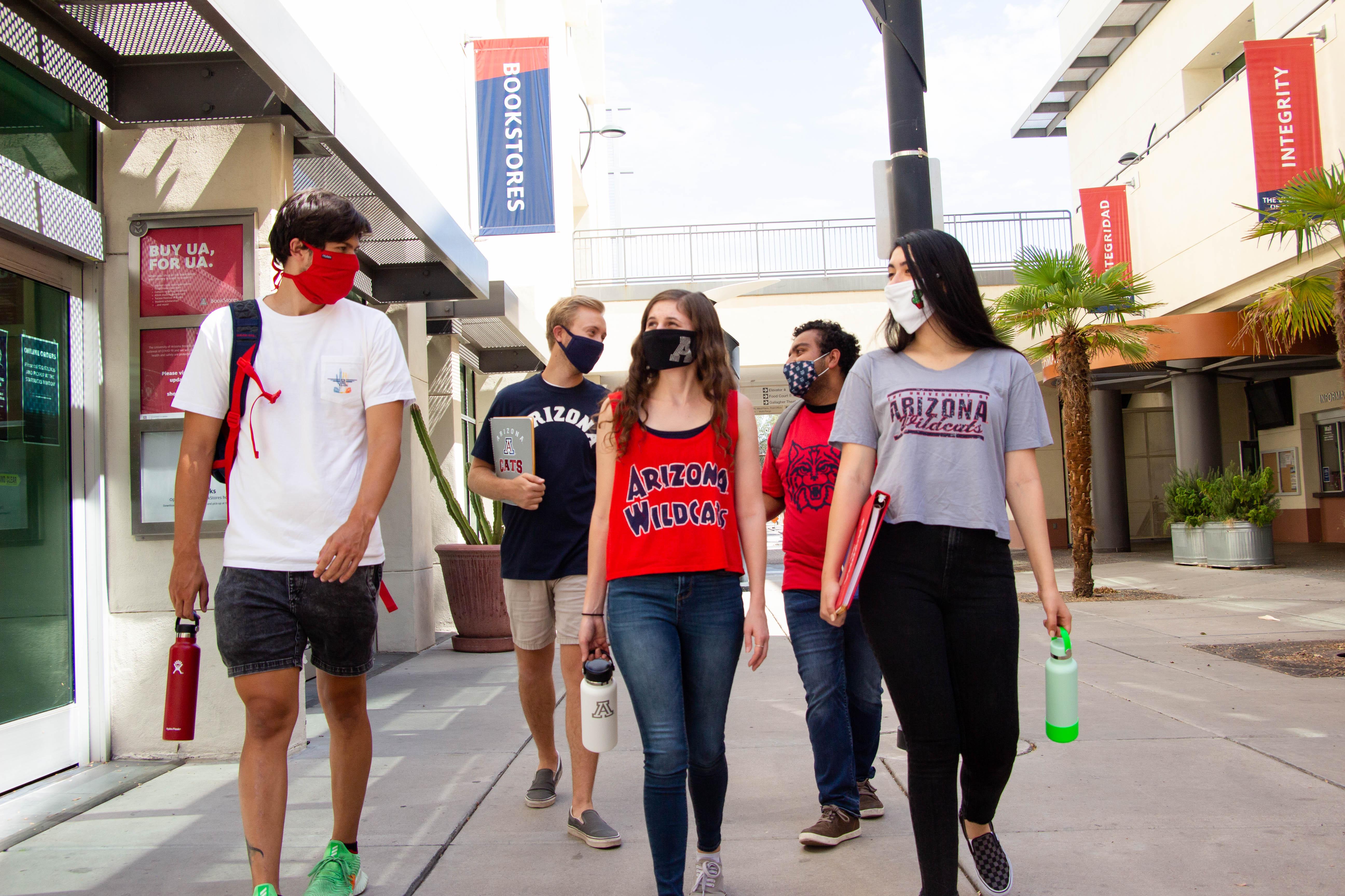 students walking together wearing masks