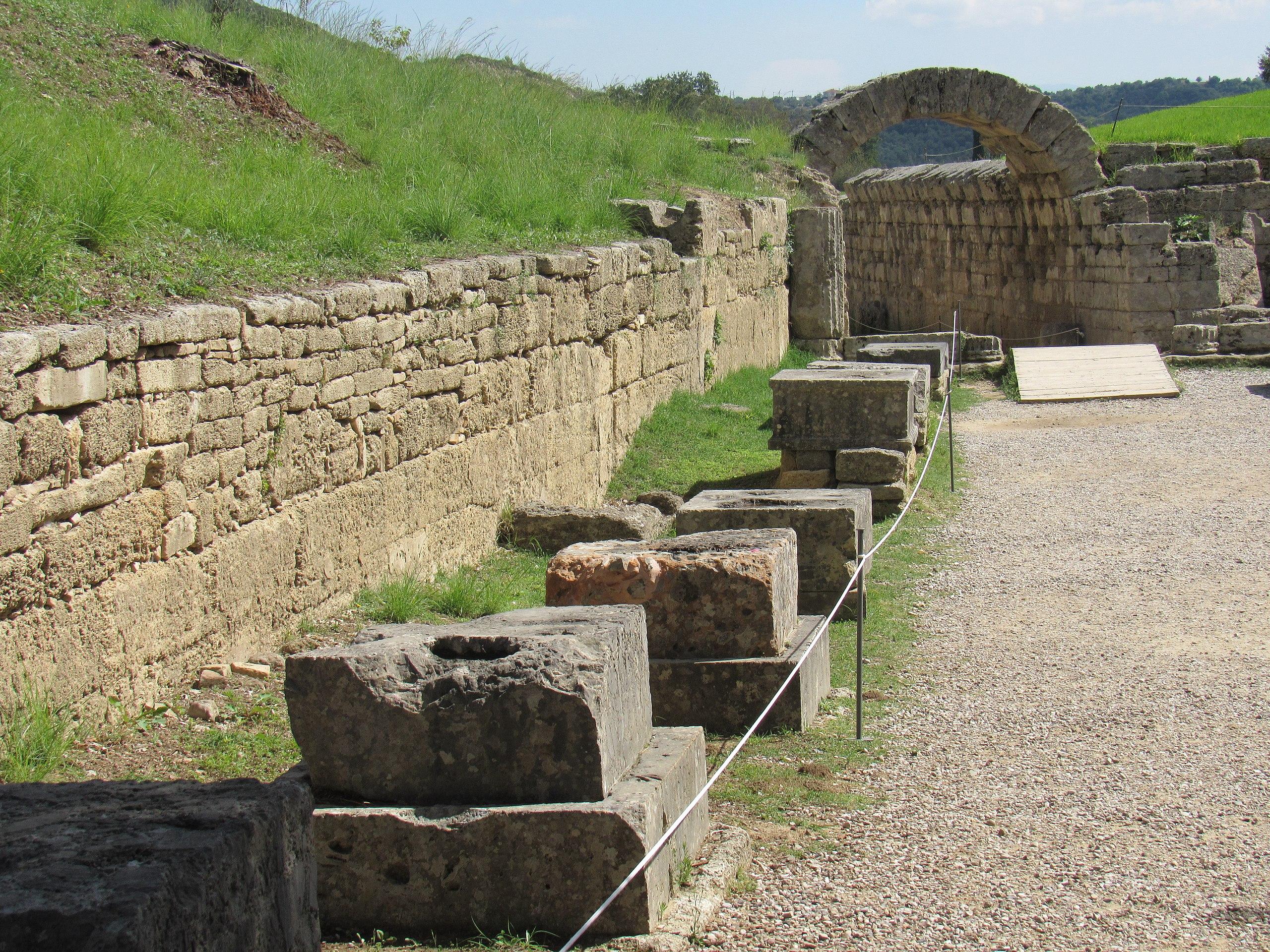 a line of stone pedestals