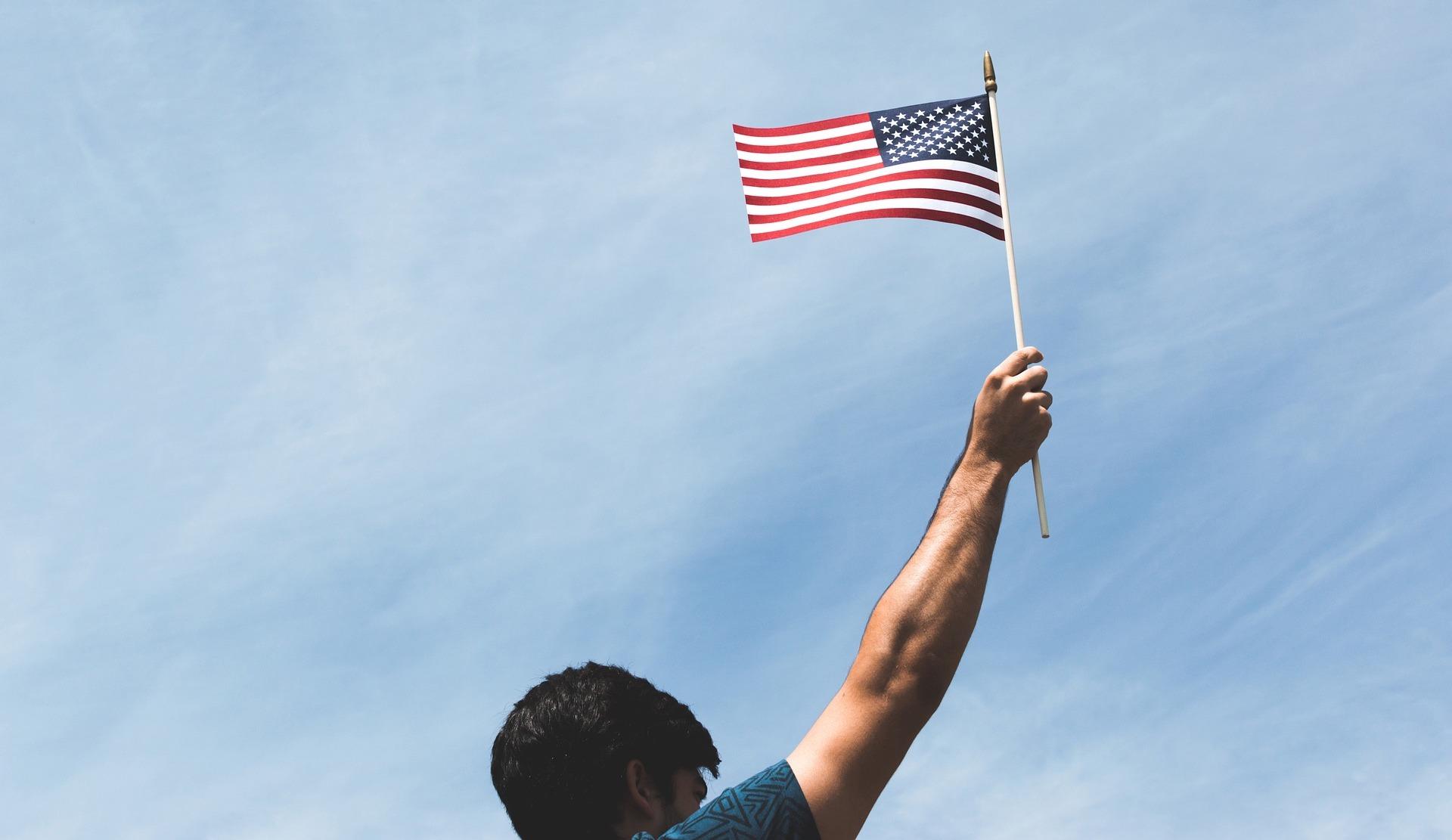 man holding an American flag