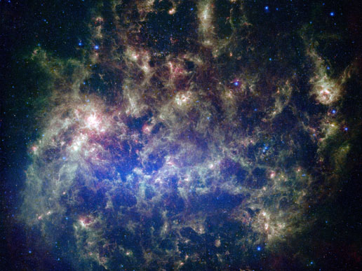 The Large Magellanic Cloud, an irregular galaxy, is visible in the night sky over the Earth's Southern Hemisphere and may contain hidden astronomical wonders yet to be revealed in the images collected by the Large Synoptic Survey Telescope.