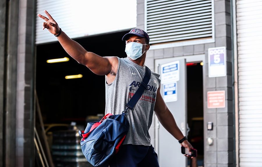 University of Arizona football players return to Arizona Stadium through Gate 8, where they were met with clear health protocols.