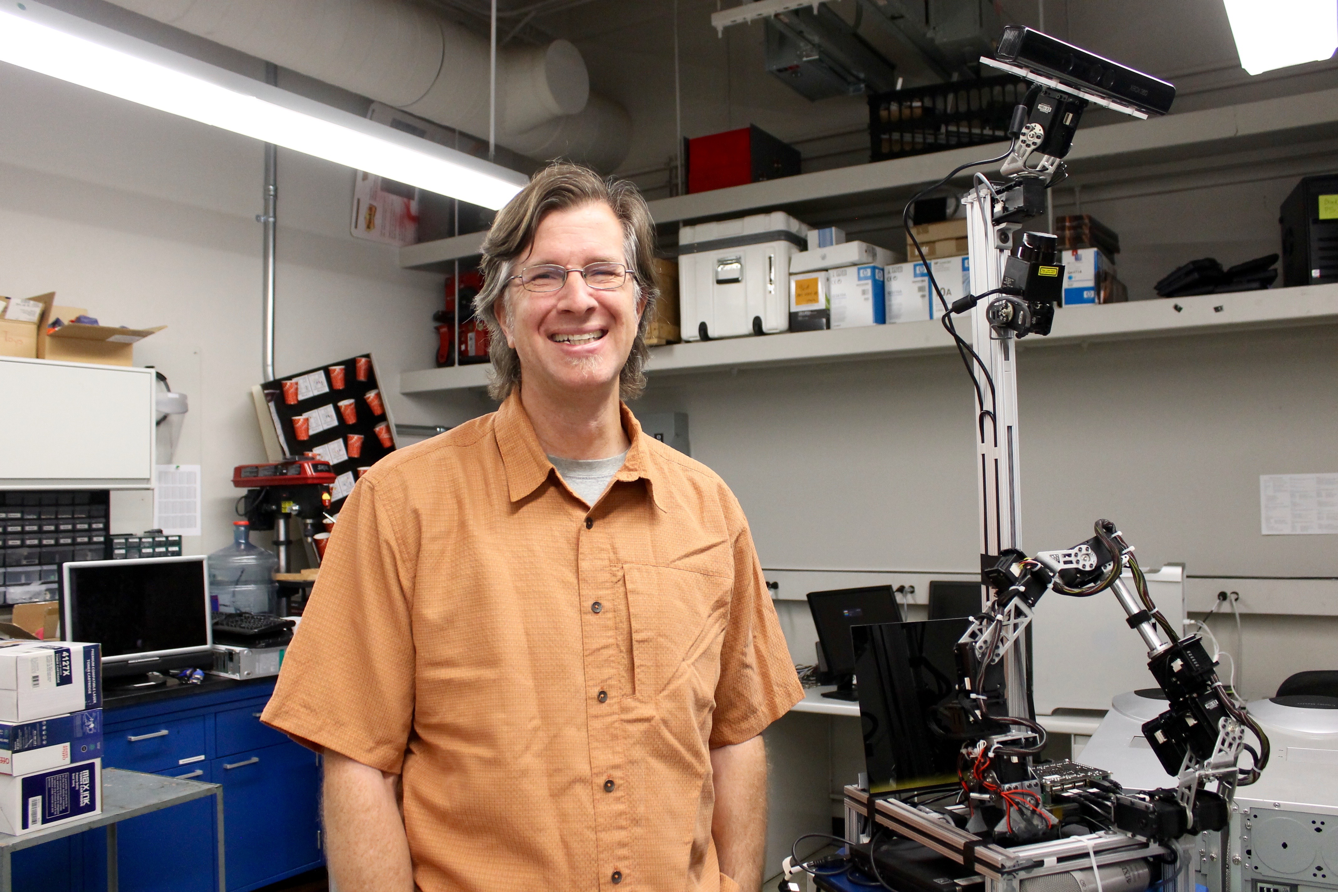 School of Information associate professor Clayton Morrison in his robotics lab