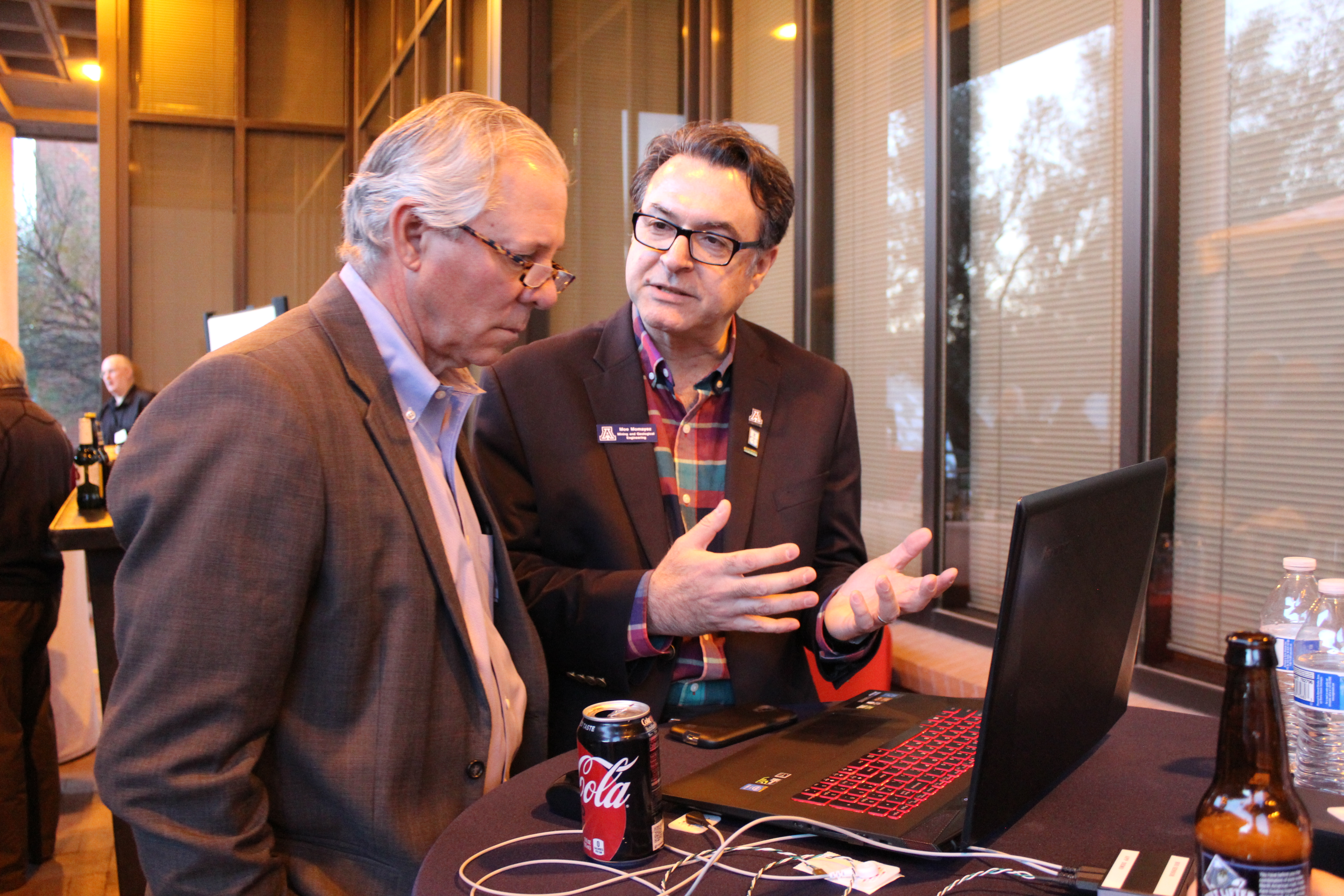 UA President Robert C. Robbins  talks with professor Moe Momayez about the mining sensor network Momayez developed and is bringing to market via the startup Guia.