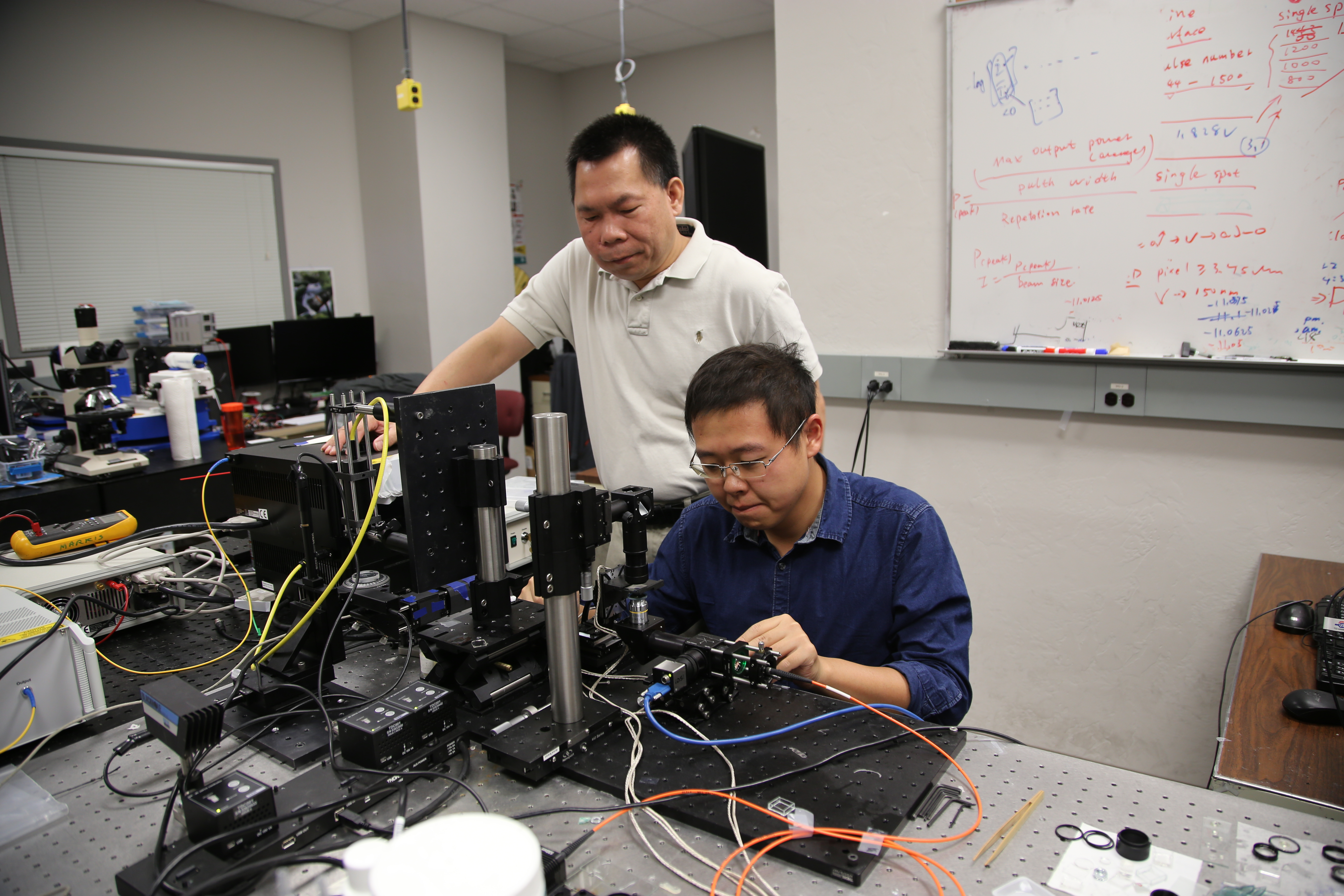 Rongguang Liang  of the College of Optical Sciences received funding to develop 3-D printing of freeform optics. He is shown here with graduate student and co-inventor Zhihan Hong.