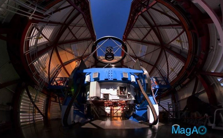 The Magellan Telescope with MagAO's Adaptive Secondary Mirror  jmounted at the top looking down some 30 feet onto the 21-foot diameter primary mirror, which is encased inside the blue mirror cell.
