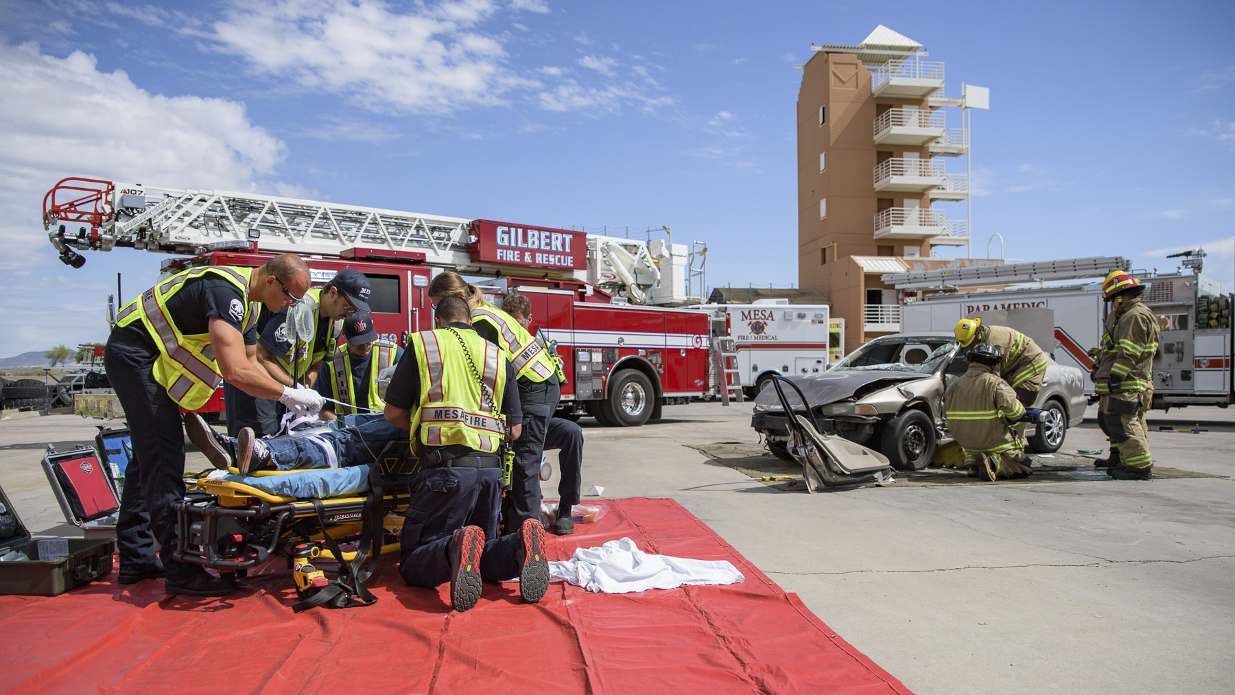 Paramedics attend to a traumatic brain injury victim during a simulated crash at the City of Mesa Public Training Facility.