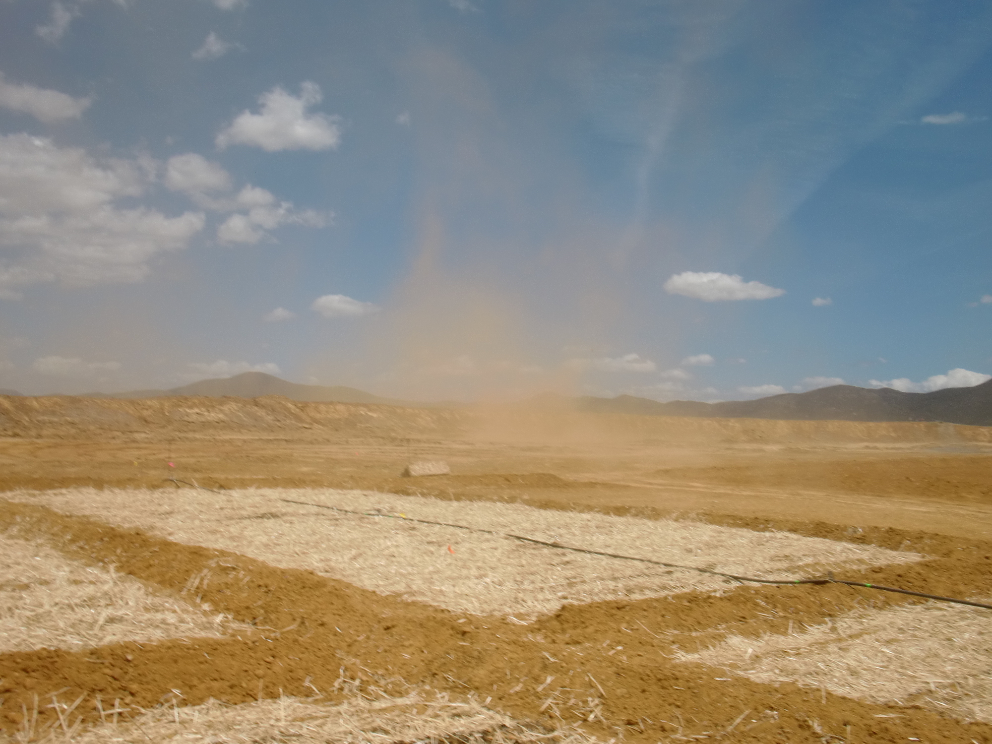 A windy morning showing dust blowing from the tailings site at the Iron King Mine.