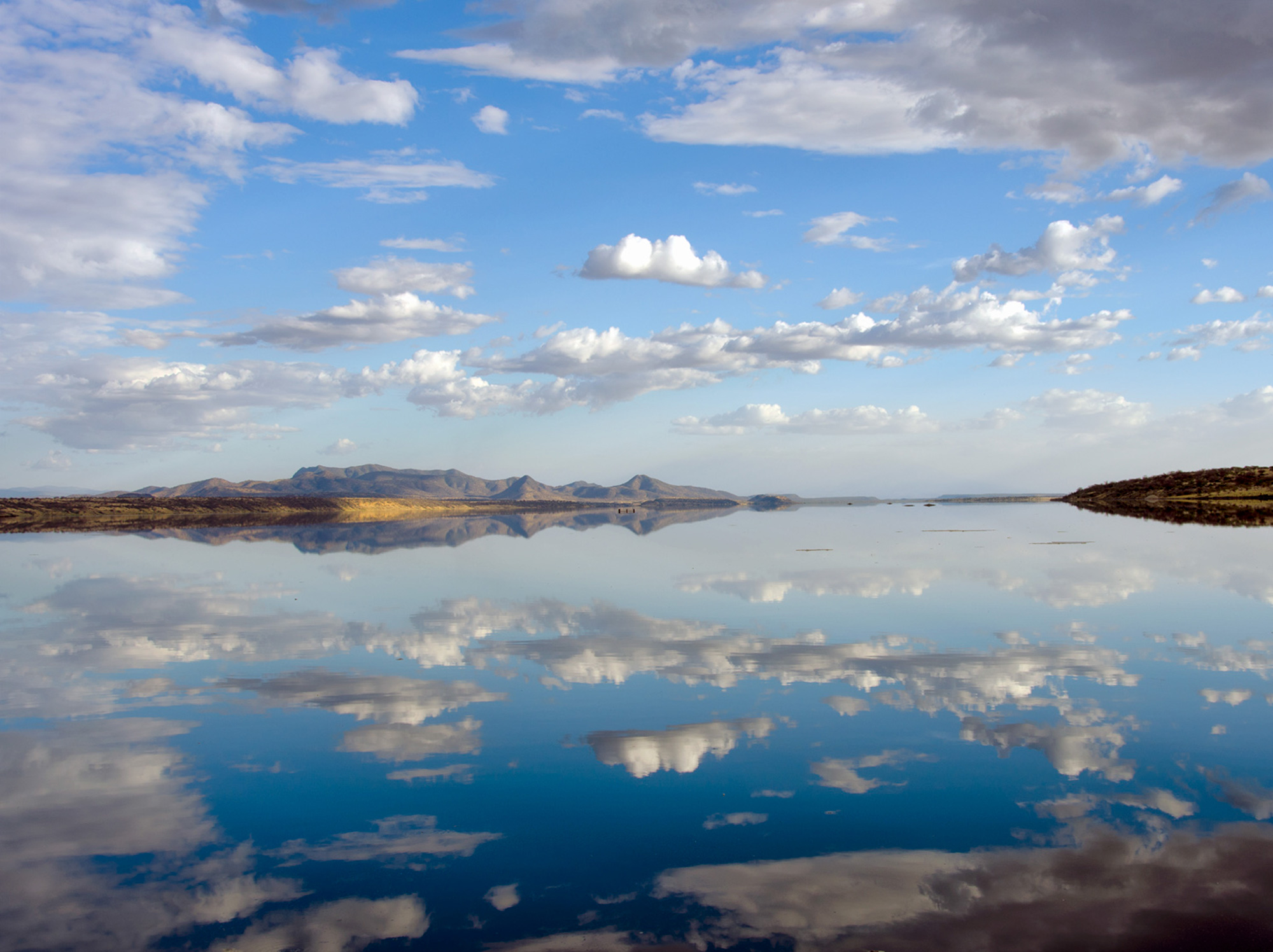 Lake Magadi, pictured during the wet season, periodically dries and floods in response to seasonal rains that cover the lakebed evaporites with up to 3 to 6 feet of water.