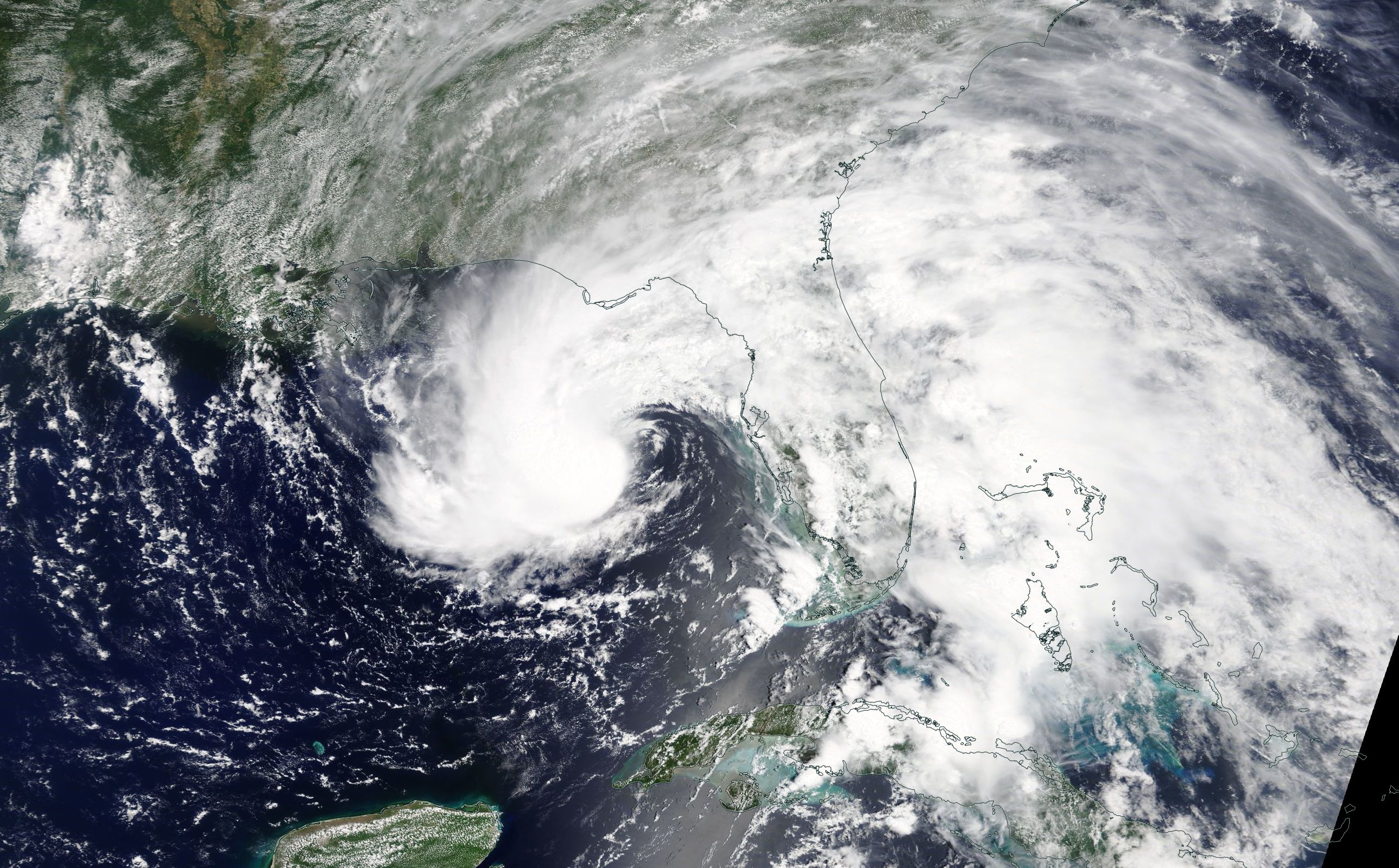 On May 27, NASA's Terra satellite captured an infrared image of subtropical storm Alberto's center of circulation hundreds of miles south of the Florida panhandle. A thick band of thunderstorms east of the center extended over the entire state of Florida.