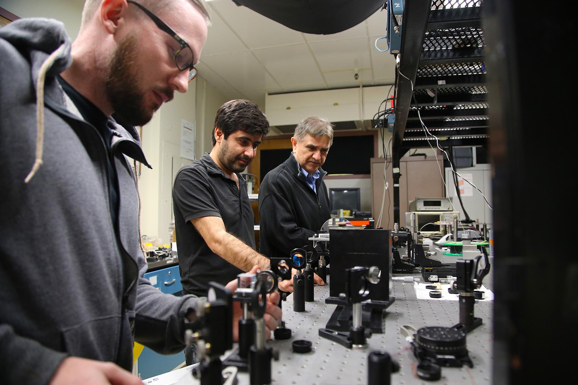 From left: Doctoral student Joshua Olsen, postdoctoral researcher Veyesi Demir, and professor and inventor Nasser Peyghambarian.