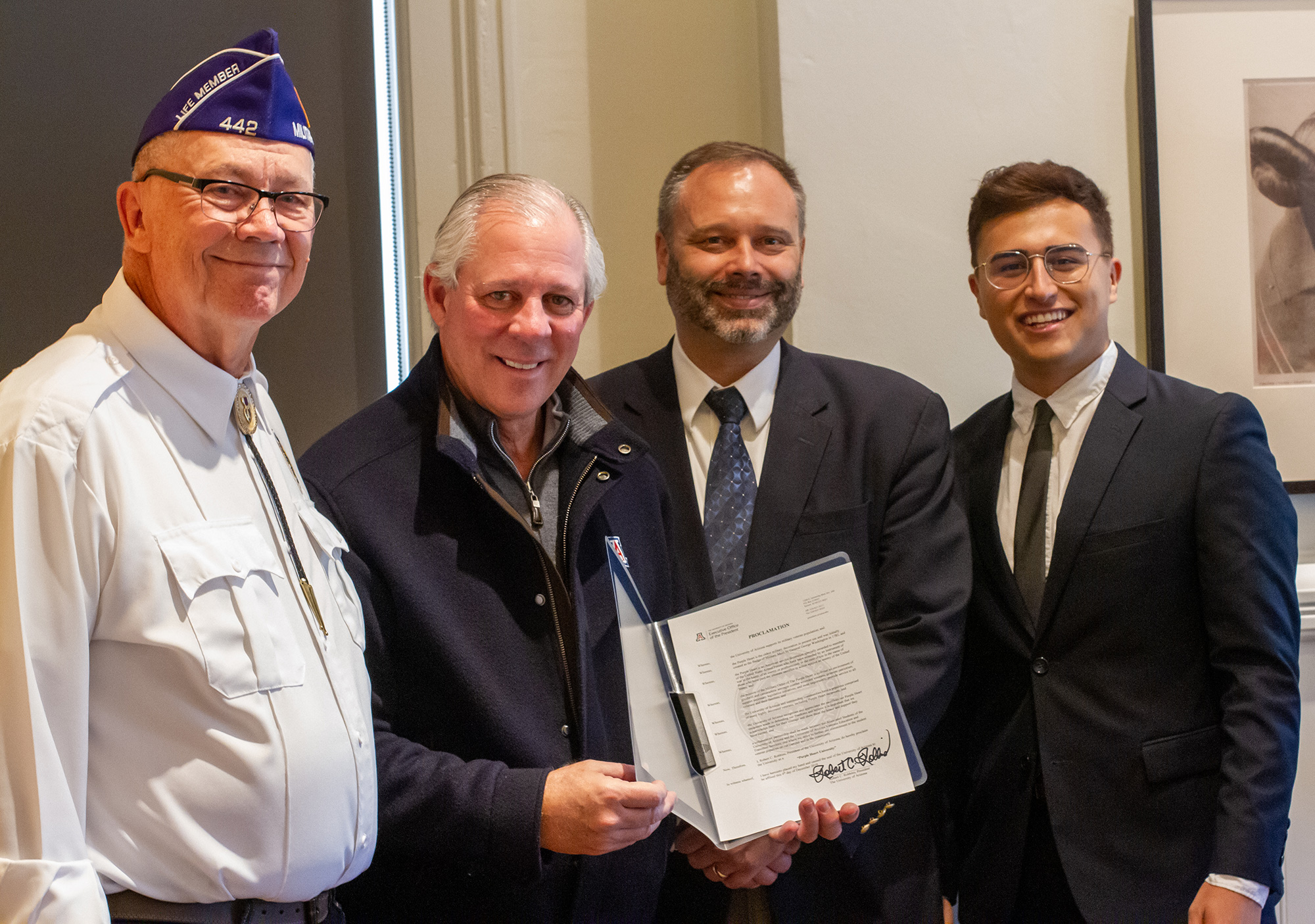 From left: Military Order of the Purple Heart Chapter 442 Commander Michael Dyer; Univerity of Arizona President Robert C. Robbins; Assistant Dean of Students Military and Veteran Engagement, Cody Nicholls; ASUA Student Body Senator Rocque Perez
