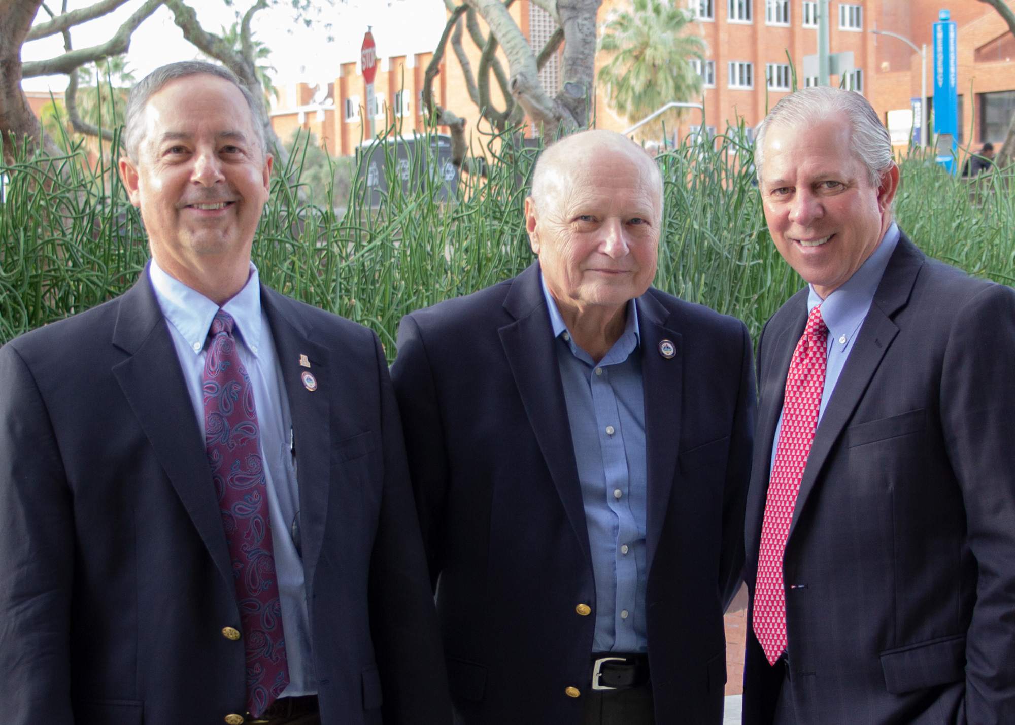 Left to right: UA College of Optical Sciences Dean Thomas Koch, Professor Emeritus James Wyant and UA President Robert C. Robbins