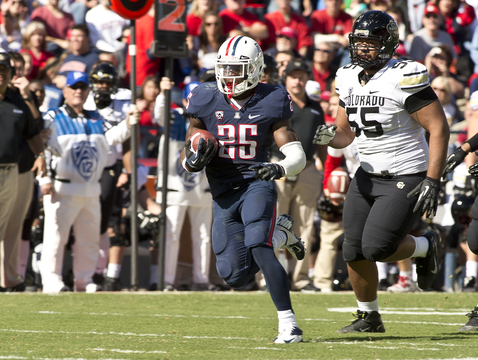 Ka'Deem Carey runs the ball against Colorado last weekend. (Photo courtesy of Arizona Athletics)
