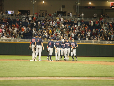 The Arizona Wildcats celebrate Saturday night's win over Miami (Fla.) in the College World Series. (Photo: Stan Liu/Arizona Athletics)
