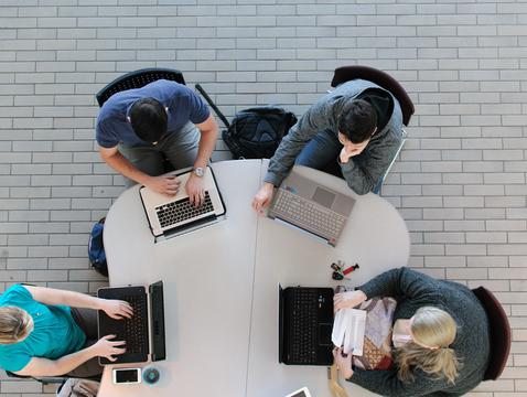 Students working in the atrium of Eller's McClelland Hall (Photo: Gregor Orbino)