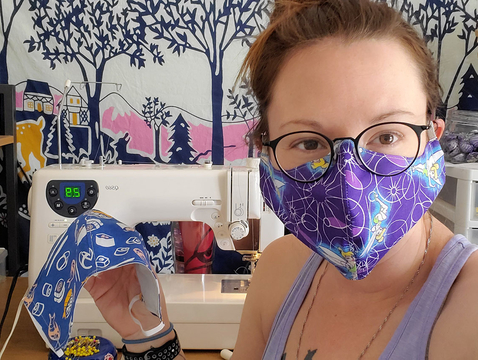 Master of Fine Arts student Rachel Wilkins models one of the dual-layer masks that she and her fellow students are making. (Photo courtesy of the College of Fine Arts)