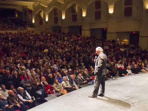 UA President Robert C. Robbins addresses the Centennial Hall audience before the start of Monday night's science lecture. (Photo: Bob Demers/UANews)