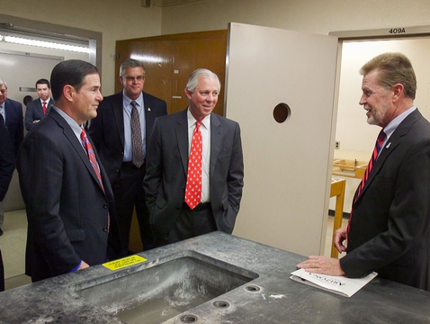 Gov. Doug Ducey (left) and UA President Robert C. Robbins (center) tour Building 90 with Bob Smith (right), vice president of University Planning, Design and Operations. (Photo: Bob Demers/UANews)