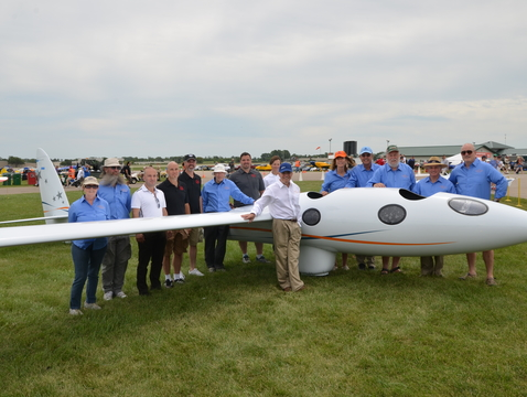 Ed Warnock (front) and the Perlan crew exhibit their glider at the Experimental Aircraft Association AirVenture show in July 2015 at Wittman Regional Airport in Wisconsin. (Photo courtesy of Ed Warnock)