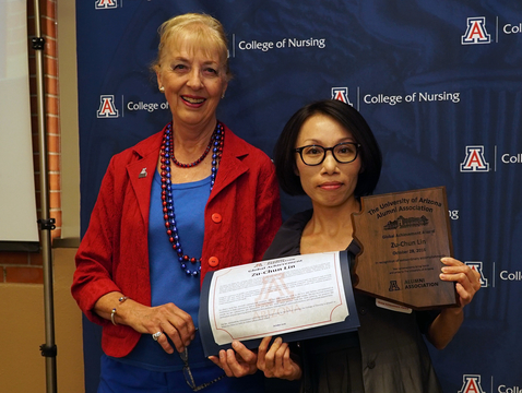 Zu-Chun Lin (right) with Joan Shaver, dean of the UA College of Nursing, at the Wildcat Nurse Alumni Awards Breakfast on Saturday. Lin received the UA's Global Achievement Award.