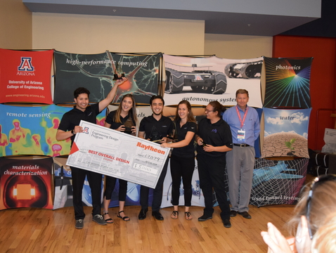 From left: Daniel Medrano, Madison Elizabeth Cooper, Jarod C. Weber, Dani McEachern and Gabriella Romano celebrate winning the Raytheon Award for Best Overall Design at the College of Engineering's 2018 Design Day.