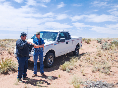 Irving Nasafotie (left) of the Hopi Tribe Office of Range Management and the UA's Dan Ferguson discuss range conditions in summer 2013 on the Hopi Tribe's lands in northern Arizona. (Photo: Michael Crimmins)