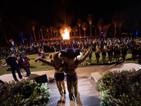 Wilma and Wilbur Wildcat greet the crowd at the annual Homecoming bonfire.