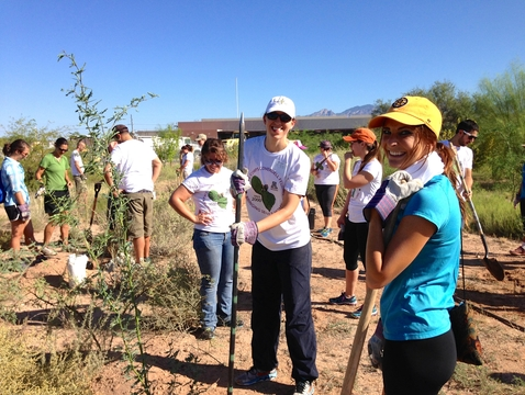 "According to the ""Report on Civic Engagement, Community Service, Social Accounting and Economic Impact: 2000-2015,"" 655 active Coverdell Fellows at the UA gave 323,450 hours of volunteer service worth over $6.5 million dollars of economic impact. One such example is a tree planting activity at Challenger High School (Photo: Georgia Ehlers/UA Graduate College)"