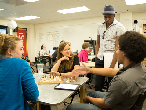 Students explain their chess project to assistant professor David Sterling Brown. (Photo: Aengus Anderson/University Libraries)