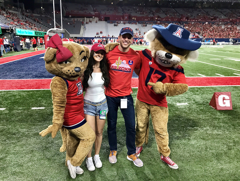 Adam Gottschalk and his girlfriend, Raven Gates, posed with Wilber and Wilma during a visit to Tucson for the UA's Homecoming festivities. (Courtesy of Adam Gottschalk)