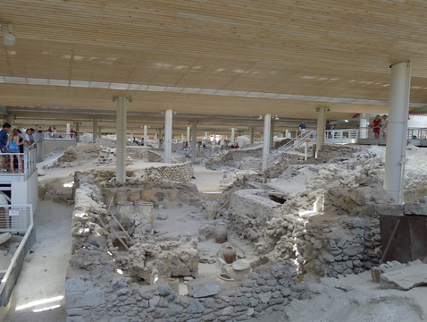 Akrotiri is the Minoan town on Santorini that was damaged by earthquakes building up to the eruption and then buried under ash once Thera erupted.The whole town site has a modern roof structure over it to protect the fragile site from the elements. (Photo: Gretchen Gibbs)