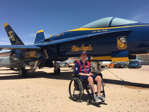 At the Pima Air and Space Museum in Tucson, Alex Spartz poses in front of a McDonnell-Douglas F/A-18A Hornet that has the paint scheme of a U.S. Navy Blue Angel.