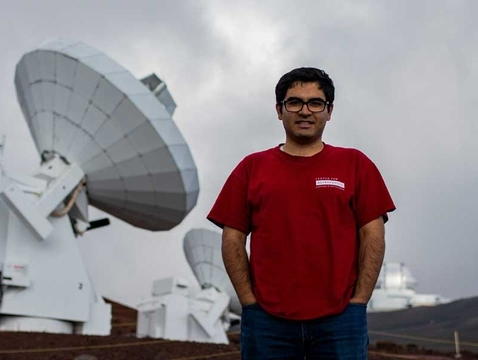Electrical engineering doctoral student Arash Roshanineshat at the Submillimeter Array, an array of eight 6-meter telescopes in Mauna Kea, Hawaii. (Courtesy of Arash Roshanineshat)