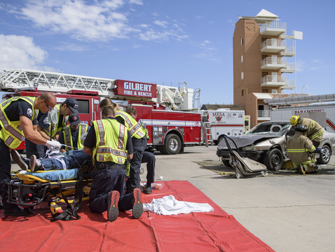 Paramedics attend to a traumatic brain injury victim during a simulated crash at the City of Mesa Public Training Facility. (Photo: Sun Belous/UA College of Medicine - Phoenix)