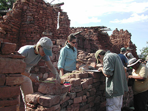 UA Field School students conducting field work in ruins preservation at Kinishba Ruins, Fort Apache Indian Reservation. (Photo: Barbara Mills)