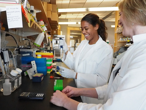 Felicia Goodrum (right) and then-student Breanna Eder work to unlock the mysteries of CMV.