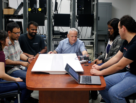 From left: Doctoral student Clarisa Grijalva Lugo, University of Sonora, Mexico professor and UA alumnus Jesus Horacio Pacheco, doctoral student Pratik Satam, professor Salim Hariri, doctoral student Shalaka Chittaranjan Satam, and assistant research professor Cihan Tunc.