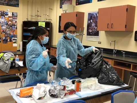 Students from Hopi High School collected garbage from their homes and brought it to class. Working in teams of two to four people, they separated the garbage into biodegradable materials, trash and materials that could be recycled. (Courtesy of the Hopi Tribe)