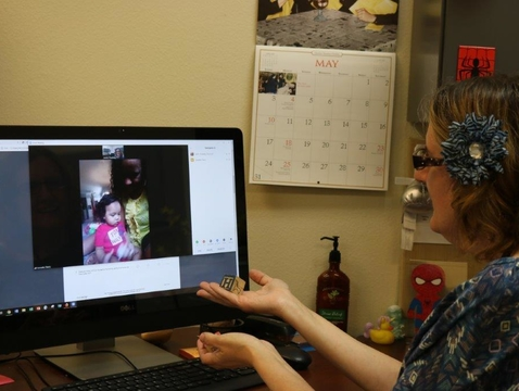Jennie Treadway, a program coordinator in the Pinal County Cooperative Extension office, completes a screening with Sonnetta Cherry and her son Luis.