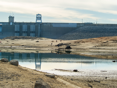 """This photo was taken Jan. 26, 2014, during California's most recent """"perfect drought"""" and shows low water drought conditions at Folsom Dam and Lake, located in Sacramento and El Dorado counties. Folsom Lake is part of the Central Valley Project, operated by the U.S. Department of the Interior and Bureau of Reclamation. (Photo: John Chacon/CADWR)"""
