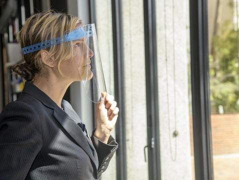 Anna Montana Cirell wears the all-laser cut face shield design. (Photo: Kris Hanning/University of Arizona Health Sciences)