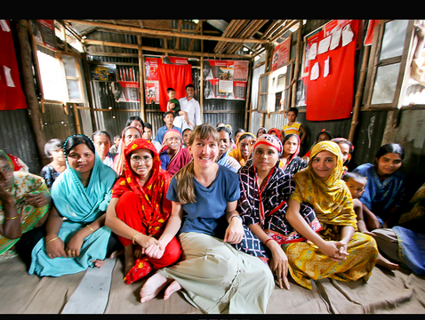 Marla Smith-Nilson, center, meets with a community group in a slum of Dhaka, Bangladesh's capital city, where millions lack access to clean water. (Photo: Water1st International)