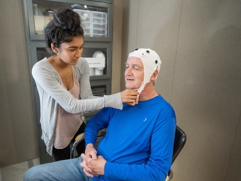 Researchers will test if exposing the brain to near-infrared light via a special cap can help enhance cognitive functioning in older adults. (Photo: University of Florida)