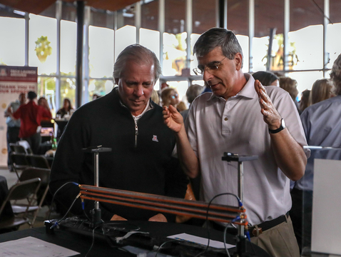 Pierre Deymier (right) and UA President Robert C. Robbins examine the acoustic system that allowed researchers to create Bell states using phonons. (Photo: Paul Tumarkin/Tech Launch Arizona)