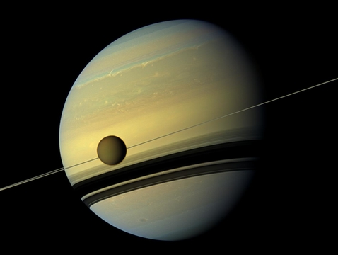 A giant of a moon appears before a giant of a planet. Titan, Saturn's largest moon, measures 3,200 miles (5,150 km) across and is larger than the planet Mercury. (Photo: NASA/JPL-Caltech/Space Science Institute)
