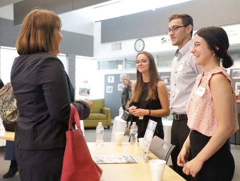 After their five-minute fast pitches, students answered questions and listened to feedback from community members. (Photo: Morgan Buttafuoco/College of Social and Behavioral Sciences)