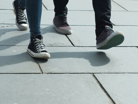While many animals walk on the balls of their feet, humans seem locked into a heel-first stride.