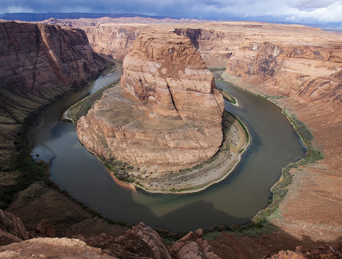 Depletion of groundwater will be more disruptive to vegetation, streams and rivers in the eastern U.S. than in the arid Southwest, where deep groundwater already is largely disconnected from surface waters, illustrated here by the Colorado River meandering through red sandstone in northern Arizona. (Photo: Daniel Stolte)