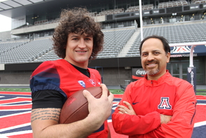 Jason Sweet and associate professor of engineering Ricardo Valerdi on the field at Arizona Stadium. (Photo: Emily Litvack/UA Office for Research & Discovery)